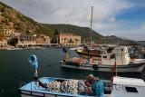 Fishermen having lunch on  boat at harbour of Assos Iskele Behram Turkey