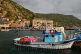 Seaside village hamlet of Assos Iskele or Behram Turkey with boats hotels and restaurants