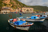 Village hamlet of Assos Iskele or Behram Turkey between sea and cliffs with boats hotels and restaurants