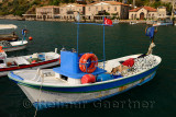 Fishing boats and hotels in the picturesque hamlet of Assos Iskele or Behram Turkey