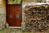 Ornate doorway with wood pile in ancient hillside village of Yesilyurt Malatya Turkey