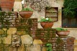 Terracotta flowerpots on an outdoor staircase wall in hillside town of Yesilyurt Malatya Turkey