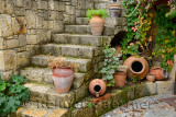 Terracotta flowerpots on an outdoor stone staircase in hillside town of Yesilyurt Malatya Turkey