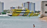 Fast Cat ferry enters Portsmouth harbour.