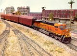 BNSF ES44AC #6003 leading a J train.