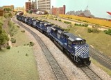 MRL 4313 leads a set of SD70ACes round the layout.