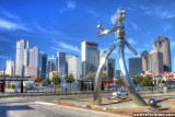 Walking Tall sculpture and Dallas Skyline