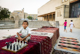 Boy with chess set - Uzbekistan