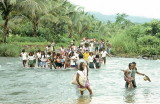Crossing the Bagumbayang River on way to a funeral