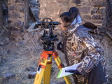 Vanessa Carrillo using a standard theodolite
