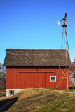 A very nicely restored barn with a nicely restored windmill next to it. This is the Coddington Barn built in 1905.
