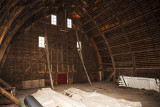This is empty but a key part of any barn is the haymow and they are always large. Here you can see the laminated rafters. Each rafter is made up of 5 boards bolted together to form the curve of the roofline.