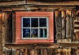 An old barn window in  the late afternoon light.