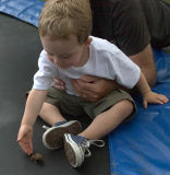 Jack helping a toad jump on a trampoline
