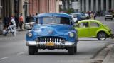 blue Buick 1950, green Volkswagen