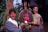 Dao and I carrying a spectacular Thai flower arrangement