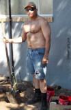 hot older guy working outside backyard.jpg