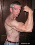 older dads flexing big arms.jpg