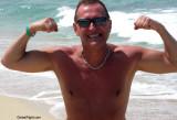 tanned hunks beach guys flexing muscles.jpg