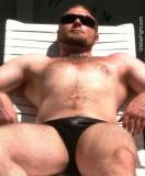 hairychested musclejock suntanning.jpg