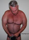 a gay powerlifter stroking big cock.jpg
