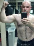 big gay powerlifter showing his big arms.jpg