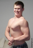 cute handsome young college freshman flexing muscle.jpg