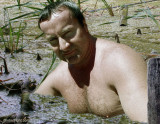 a man sitting swamp lake soaking wet guy.jpg