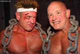 bloody face pro wrestlers wearing chains.jpg