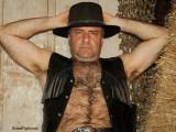 cowboy older man arms raised gray armpits.jpg