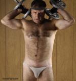hairy man biceps workout pumping weights.JPG