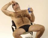 hot man cooling off beach lounge chair.jpg