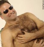 man grabbing his nips pinching nipples.jpg