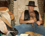 ranch hand removing jeans leather cowboy man.jpg