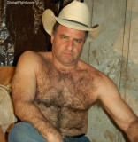 rancher taking off boots removing clothes.jpg