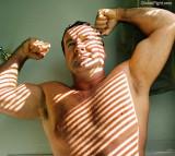 dad flexing sunlight gay beefy bears.jpg