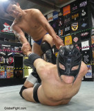 leather mask pro wrestlers fighting men.jpg