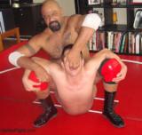 black leather bear dominating slave boy.jpg