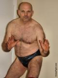hairy pro wrestler men posing backstage.jpg