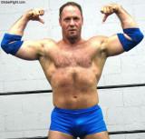 musclebear daddy flexing big arms.jpg