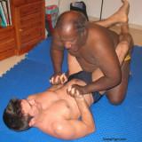 older cute black man fighting younger white dudes.jpg