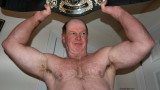 wrestling champion holding pro belt up.jpg