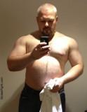 bearded bearish daddie removing shirt.jpg