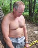 dad working hard cutting firewood sweaty.jpg
