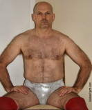 gay prowrestler sitting skimpy tight outfit.jpg