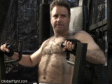 hairy handsome man lifting weights.jpg