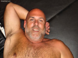 handsome hairy bear arms behind head.jpg