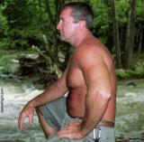 man sitting stream lake outdoors.jpg