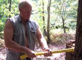 muscular older tough daddie chopping wood.jpg