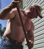 stocky man working yard.jpg